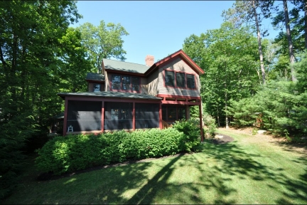 Great Winnipesaukee Summer Rental!  Southwest Exposure!  Quiet, Peaceful Location.  Premier Builder!: Charming 4 bedroom home! $4950 a week.  Sleep 8.  This Cargill Blake luxury lake house was designed with a Frank Loyd Wright influence. Located in one of the most private areas on Winnipesaukee. Loons are frequent visitors.  This is a rare spot! This is one of the few places on the lake so peaceful that loons love to sing nearby in the evenings. A very charming bunkhouse with fireplace and screen porch also graces this property and could be used as a seasonal bedroom. The home has 4 bedrooms or you can use the 4th bedroom as a family room, complete with full bath and wood stove hook up. Heart pine floors, large NH fieldstone fireplace in the living room, and screen porch on the main house. Enjoy sunsets and southwesterly views of the twin islands and Gunstock Mountain. The landscape includes a lawn on both the lakeside and roadside, gardens with perennials, walkways and beautiful old maple trees. 1.3 miles to Bald Peak Colony Club. 10-20 minutes to Moultonborough, Wolfeboro and Center Harbor amenities.